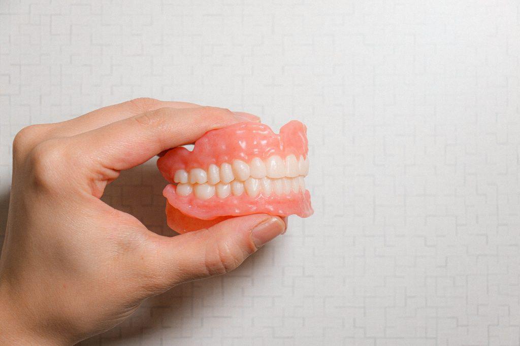 New dentures being held in someones hand